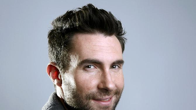 """FILE - This Feb. 20, 2012 file photo shows Maroon 5 frontman Adam Levine in New York. The musician and star of TV's """"The Voice"""" is up for favorite band, song, album and music video, along with favorite celebrity judge and favorite competition TV show for the People's Choice Awards. Nominations were announced Thursday, Nov. 15, at the Paley Center for Media in Beverly Hills, Calif. Fans chose the nominees by voting online and can do the same to select the winners. Voting in 48 categories continues through Dec. 13. The People's Choice Awards will be presented Jan. 9, 2013, and broadcast on CBS. (AP Photo/Carlo Allegri, file)"""