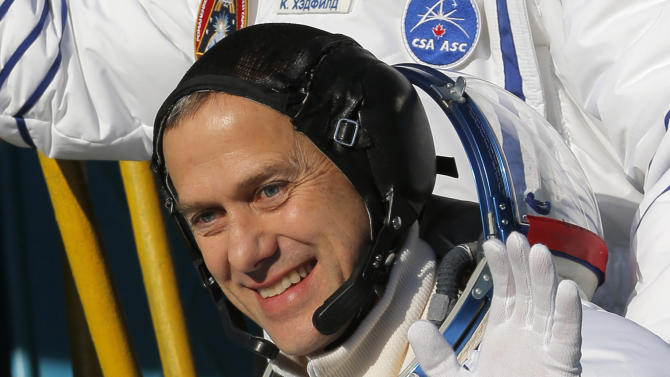 U.S. astronaut Thomas Marshburn, a crew member of the mission to the International Space Station, gestures prior to the launch of the Soyuz-FG rocket at the Russian leased Baikonur cosmodrome, Kazakhstan, Wednesday, Dec. 19, 2012.  (AP Photo/Dmitry Lovetsky, Pool)