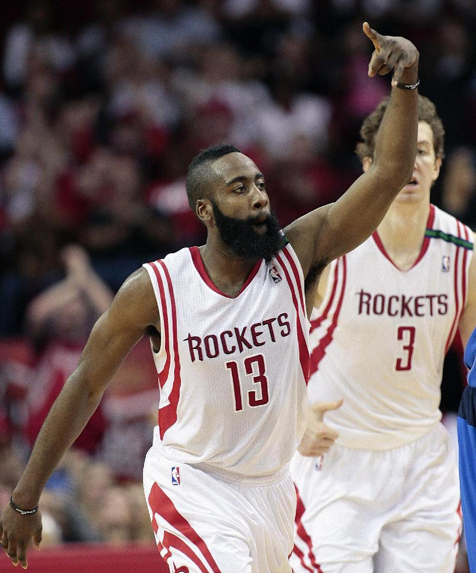 Houston Rockets' James Harden (13) motions after hitting a three-point shot against the Dallas Mavericks during the first half of an NBA basketball game, Saturday, Dec. 8,  2012, in Houston. (AP Photo/Bob Levey)