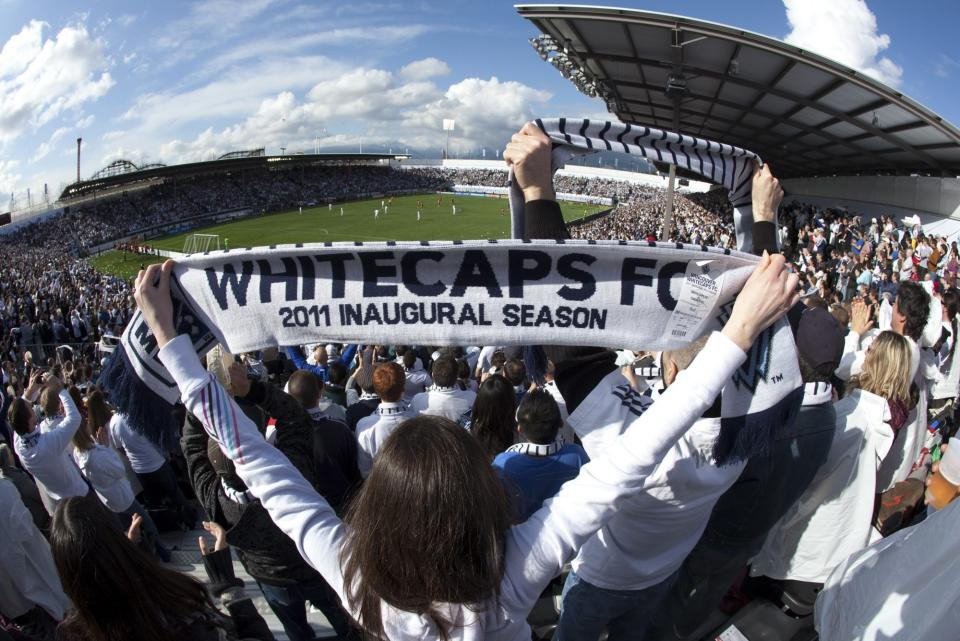 A Vancouver Whitecaps FC fan celebrates the teams first goal during the first half of an MLS soccer action against the Toronto FC in Vancouver, British Colombia, on Saturday March 19, 2011. (AP Photo/The Canadian Press, Jonathan Hayward)