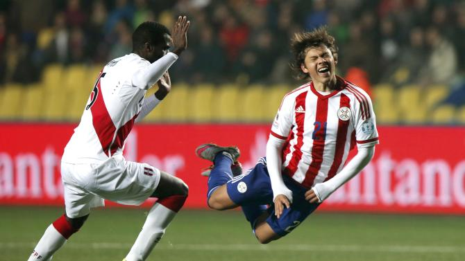 Paraguay's Romero is tackled by Peru's Ramos during their Copa America 2015 third-place soccer match at Estadio Municipal Alcaldesa Ester Roa Rebolledo in Concepcion