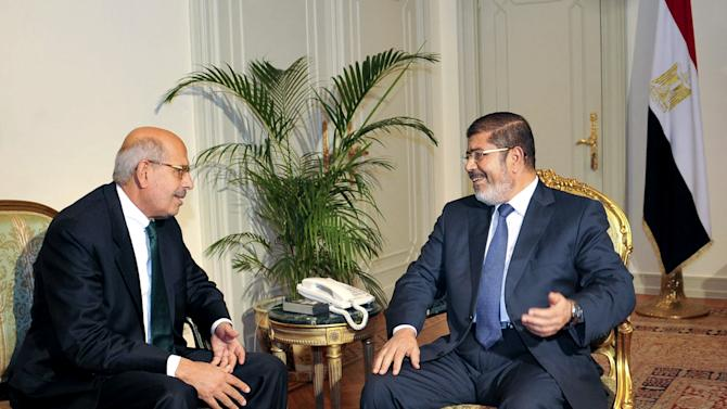 "FILE - In this Tuesday, Nov. 13, 2012 file photo, released by the Egyptian Presidency, Nobel Peace Prize winner and head of the opposition Egyptian Constitution political party, Mohamed ElBaradei, left, meets with  Egyptian President Mohammed Morsi, in Cairo, Egypt. An Egyptian opposition leader is calling for a boycott of upcoming parliamentary elections, a day after he said the vote will inflame the country's political tensions. Mohamed ElBaradei, who leads the main opposition National Salvation Front, wrote on Twitter Saturday, Feb. 23, 2013 that he is calling for the boycott ""to expose sham democracy,"" as he said he did in a similar call in 2010 under then-president Hosni Mubarak. ElBaradei says he urges the boycott of the vote called by Islamist President Mohammed Morsi because he ""will not be part of an act of deception.""  (AP Photo/Egyptian Presidency, File)"