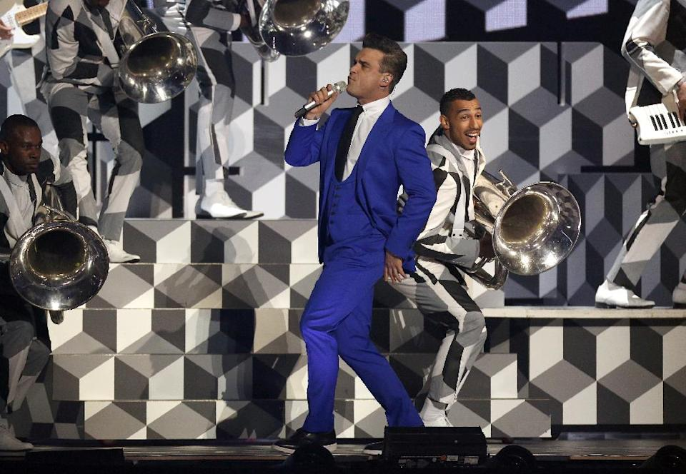 Robbie Williams performs on stage during the BRIT Awards 2013 at the o2 Arena in London on Wednesday, Feb. 20, 2013. (Photo by Joel Ryan/Invision/AP)