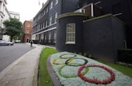 A flower arrangement depicting the Olympic Rings outside the prime minister's official residence at Downing Street in London on July 17. US fans of the Olympics will be tracking the summer games on multiple screens, turning to tablets and smartphones for news, survey results showed
