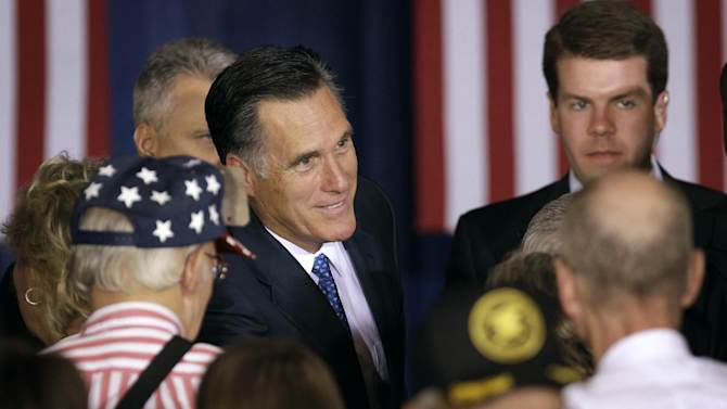 Republican presidential candidate, former Massachusetts Gov. Mitt Romney greets supporters after speaking at a campaign stop, Tuesday, May 15, 2012, in Des Moines, Iowa. (AP Photo/Charlie Neibergall)