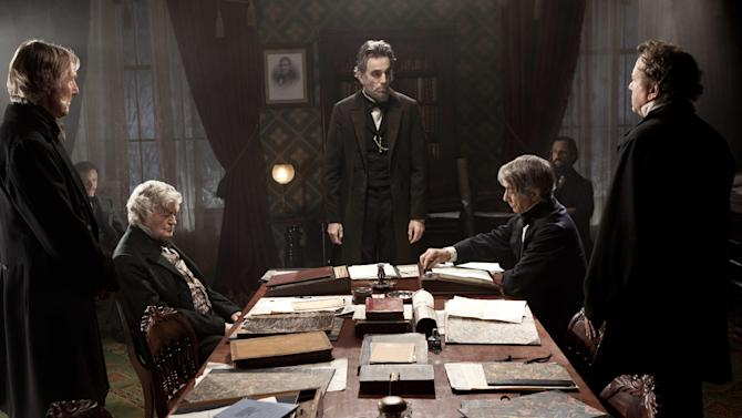 """FILE - This undated publicity photo released by DreamWorks and Twentieth Century Fox shows, Daniel Day-Lewis, center rear, as Abraham Lincoln, in a scene from the film, """"Lincoln.""""  Day-Lewis, who plays the 16th president in Steven Spielberg's epic film biography """"Lincoln,"""" settled on a higher, softer voice, saying it's more true to descriptions of how the man actually spoke. """"Lincoln"""" opened in limited release Nov. 9, 2012, and expands nationwide Friday, Nov. 16. (AP Photo/DreamWorks, Twentieth Century Fox, David James, File)"""
