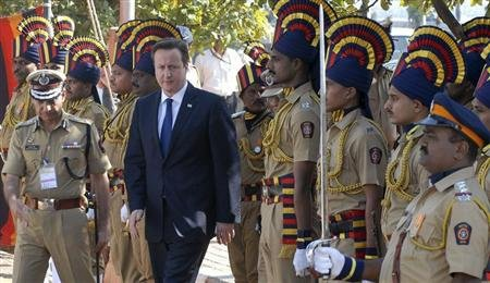 Britain&#39;s Prime Minister David Cameron arrives to pay tributes at a memorial dedicated to policemen who lost their lives in November 2008 attacks, in Mumbai February 18, 2013. Cameron arrived in India on Monday as a graft scandal engulfed an Anglo-Italian helicopter deal and immediately told his hosts they should open up their economy because Britain has done the same for Indian firms. REUTERS/Stringer