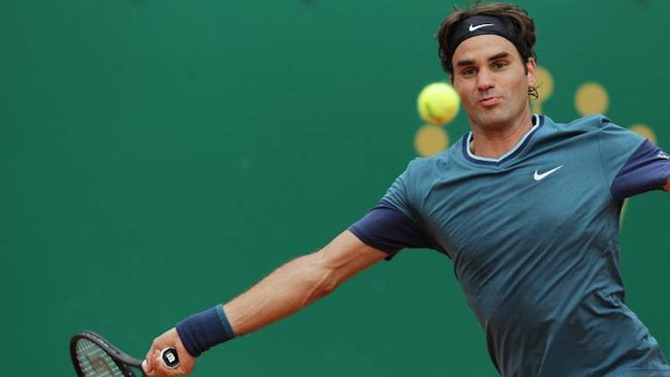 Swiss Roger Federer returns the ball to France's Jo-Wilfried Tsonga during their Monte-Carlo ATP Masters Series Tournament tennis match, on April 18, 2014, in Monaco