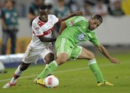 Stuttgart&#39;s midfielder Ibrahima Traore (L) and Wolfsburg&#39;s defender Ricardo Rodriguez fight for the ball during their German first division Bundesliga football match at the Mercedes-Benz arena in Stuttgart, southwestern Germany. Wolfsburg claimed a late a 1-0 victory over Stuttgart