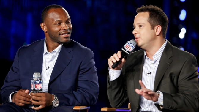 Former NFL player Fred Taylor and Michael Fabiano are seen during the DirecTV NFL Fantasy Week on Thursday, Aug. 23, 2012 at the Best Buy theatre in Times Square in New York. (Photo by Brian Ach/AP Images for NFL)