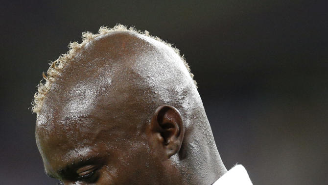 Italy's Mario Balotelli walks head-down during the Euro 2012 soccer championship final  between Spain and Italy in Kiev, Ukraine, Sunday, July 1, 2012.  (AP Photo/Michael Sohn)