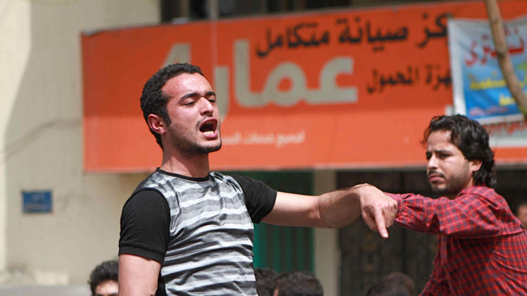 "This April 1, 2011 photo shows activist Ahmed Douma chanting slogans during a march to Tahrir Square demanding prosecution of members of former President Hosni Mubarak's regime in Cairo, Egypt. An Egyptian prosecutor says prominent Douma was arrested and referred to a speedy trial for insulting the country's president in comments he made on TV, in the first such case. Prosecutor Mohammed Tanikhi said Thursday, May 2, 2013 that Douma's trial begins Sunday. He was arrested Tuesday after a Muslim Brotherhood member complained that Douma called Morsi a ""killer"" and a ""criminal"", blaming him for a violent security crackdown on protesters in the coastal city of Port Said that left 40 people killed. (AP Photo/Sarah Carr)"