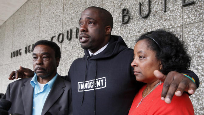 Brian Banks, center, reacts with his mother, Leomia Myers and father, Jonathan Banks, outside court after his rape conviction was dismissed Thursday May 24, 2012 in Long Beach, Calif. Banks, a former Long Beach high school football star and prized college recruit who served more than five years in prison for a rape he did not commit had his conviction overturned Thursday with his accuser recanting her story( AP Photo/Nick Ut)