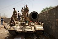 Soldiers from the Yemeni army sit on a tank at their base in the city of Jaar on June 15. Four Yemeni soldiers and a civilian were killed in an attack on Wednesday by Al-Qaeda militants on a police station in the southern town of Jaar, a local official said