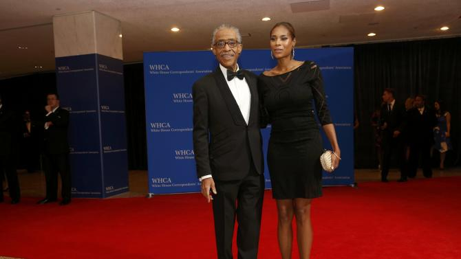 The Reverend Al Sharpton and guest arrive for the annual White House Correspondents' Association dinner in Washington