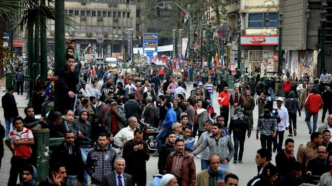 Egyptian protesters gather near Tahrir Square, in Cairo, Egypt, Thursday, Jan. 24, 2012. Egypt's black-clad riot police fired tear gas in fierce dawn clashes with dozens of protesters on Thursday when they tried to tear down a cement wall built to prevent demonstrators from reaching parliament and the Cabinet building. The violence which was soothed hours later in central Cairo comes on eve of the second anniversary of Egypt's Jan. 25 uprising, which toppled longtime authoritarian president Hosni Mubarak in 2011. (AP Photo/Hussein Tallal)