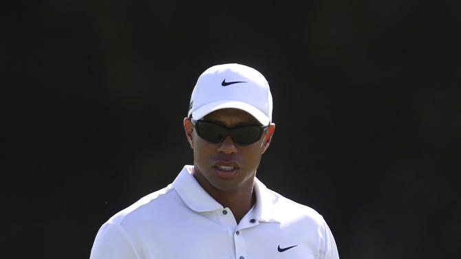 U.S. golfer Tiger Woods walks along the 14th fairway during the second round of the Australian Open golf tournament in Sydney, Australia, Friday, Nov. 11, 2011. Woods started the second round at 4 under the card. (AP Photo/Rob Griffith)