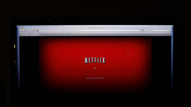 """FILE - In this Monday, Nov. 22, 2010, file photo, a movie selected from among Netflix's """"Watch Instantly"""" titles begins to download on a home computer screen in New York. Netflix is testing new price plans for streaming video as it tries to lure more viewers. (AP Photo/James H. Collins, File)"""