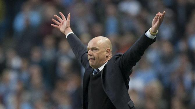 Wigan's manager Uwe Rosler celebrates as his team beat Manchester City 2-1 during their English FA Cup quarterfinal soccer match at the Etihad Stadium, Manchester, England, Sunday, March 9, 2014