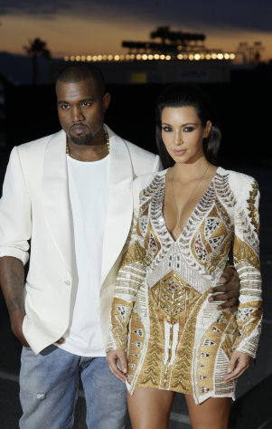 "FILE - In this May 23, 2012 file photo, singer Kanye West, left, and television personality Kim Kardashian arrive for the screening of ""Cruel Summer"" at the 65th international film festival, in Cannes, southern France. Now that Beyonce and Jay-Z have confirmed that they're attending the BET Awards, on Sunday, July 1, 2012, the next question is: Will West be the third wheel, or will his girlfriend Kardashian be on his arm? (AP Photo/Francois Mori, File)"