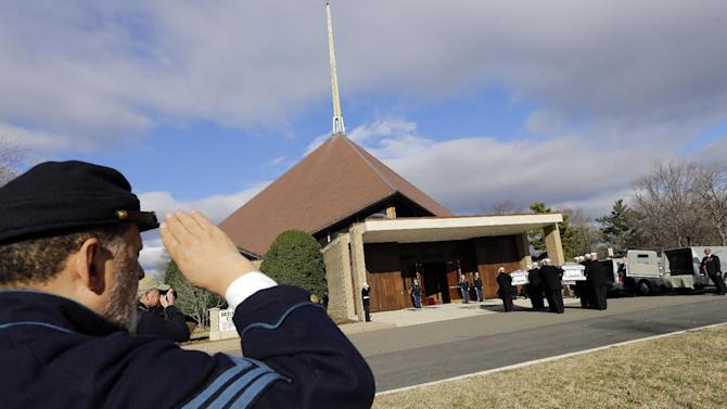 A man in Civil War period attire salutes as two flag draped caskets arrive at Fort Meyer Memorial Chapel for services to honor two sailors from the Civil War ship, the USS Monitor, Friday, March 8, 2013 in Arlington, Va. A century and a half after the Civil War ship the USS Monitor sank, two unknown crewmen found in the ironclad's turret were buried at Arlington National Cemetery. Friday's burial may be the last time Civil War soldiers are buried at the cemetery. (AP Photo/Alex Brandon)