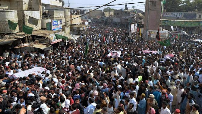 Thousands of Pakistani mourners attend funeral procession of victims of a bombing Friday in Shikarpur, some 500 kilometers (310 miles) north of Pakistan's port city of Karachi, Saturday, Jan. 31, 2015. Thousands of Shiites across Pakistan mourned and protested Saturday after a bomb at a Shiite mosque in the country killed more than 55 people.  (AP Photo/Khalid Hussain)