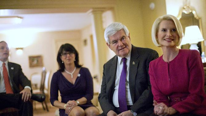 Republican presidential candidate former House Speaker Newt Gingrich, second form right, watches returns from a hotel room with wife Callista, right, daughter Jackie Gingrich Cushman, left, and her husband Jimmy Cushman, far left, before the Alabama Primary night rally Tuesday, March 13, 2012, in Birmingham, Ala. (AP Photo/David Goldman)