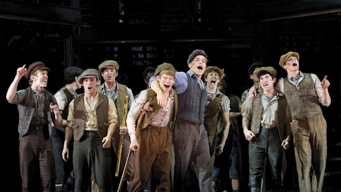 "In this theater image released by Disney Theatricals, the cast of The Paper Mill Playhouse Production of ""Newsies,"" starring Jeremy Jordan, center right, is shown in New York. The hit musical ""Newsies,"" which earned Tonys for best score and choreography, broke the house record at the Nederlander Theatre with a gross of $1,049,581.  (AP Photo/Disney Theatricals, T. Charles Erickson)"