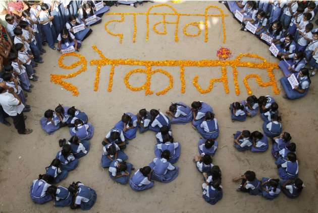 Indian schoolgirls form numbers representing the year 2013 during a prayer ceremony in Ahmadabad, India, Monday, Dec. 31, 2012. The gang-rape and killing of a New Delhi student has set off an impassio