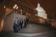 "Members of the House of Representatives leave after voting for legislation to avoid the ""fiscal cliff"" during a rare New Year's Day session January 1, 2013 in Washington, DC. President Barack Obama signs the ""fiscal cliff"" deal into law but the IMF and rating agencies warn deficits and debt still threaten the US economy"