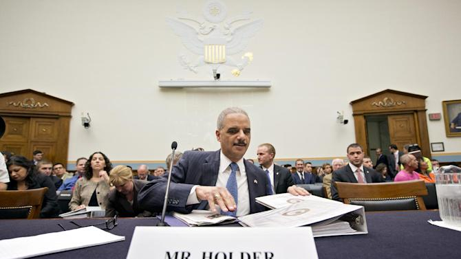 Attorney General Eric Holder, the nation's top law enforcement official, prepares to testify on Capitol Hill in Washington, Wednesday, May 15, 2013, before the House Judiciary Committee oversight hearing on the Justice Department. House Judiciary Committee Chairman Rep. Bob Goodlatte,R-Va., wants to know more about the unwarranted targeting of Tea Party and other conservative groups by the Internal Revenue Service and the Justice Department's secret seizure of telephone records at The Associated Press.  (AP Photo/J. Scott Applewhite)