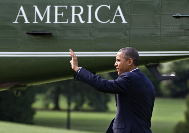 President Barack Obama walks to the Marine One helicopter on the South Lawn of the White House in Washington, Friday, July 13, 2012, as he heads to campaign in Virginia. (AP Photo/J. Scott Applewhite)