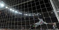Athletic Bilbao's goalkeeper Gorka Iraizoz dives for the ball as Atletico Madrid's Diego scores the 3-0 during the UEFA Europa League final football match between Atletico Madrid and Athletic Bilbao at the National Arena stadium in Bucharest. A double by Falcao inspired Atletico Madrid to a 3-0 win over Athletic Bilbao and their second Europa League trophy in three seasons