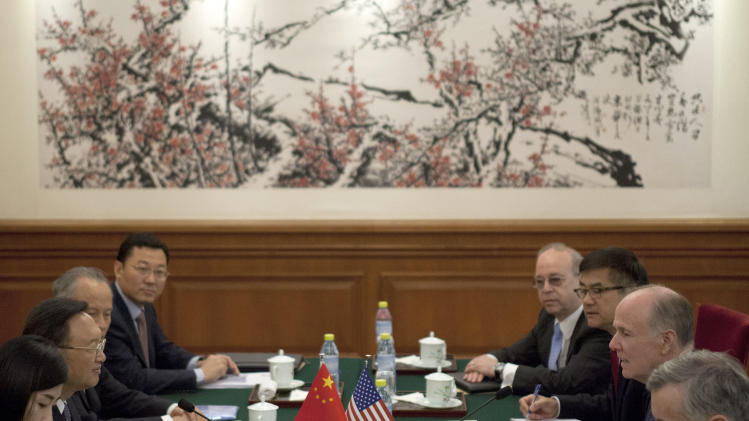 U.S. National Security Adviser Tom Donilon, second from right,  and Chinese State Councilor Yang Jiechi, second from left, talk during their meeting at Diaoyutai State Guesthouse in Beijing, China, Monday, May 27, 2013. (AP Photo/Alexander F. Yuan, Pool)