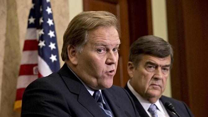 """House Intelligence Committee Chairman Rep. Mike Rogers, R-Mich., left, and the committee's ranking Democrat, Rep. C.A. """"Dutch"""" Ruppersberger, D-Md., right, participate in a news conference on Capitol Hill in Washington, Monday, Oct. 8, 2012, where they released a report on a yearlong probe of China's two leading technology firms, Huawei Technologies Ltd. and ZTE Corp., warning they pose a major security threat to the US. (AP Photo/J. Scott Applewhite)"""