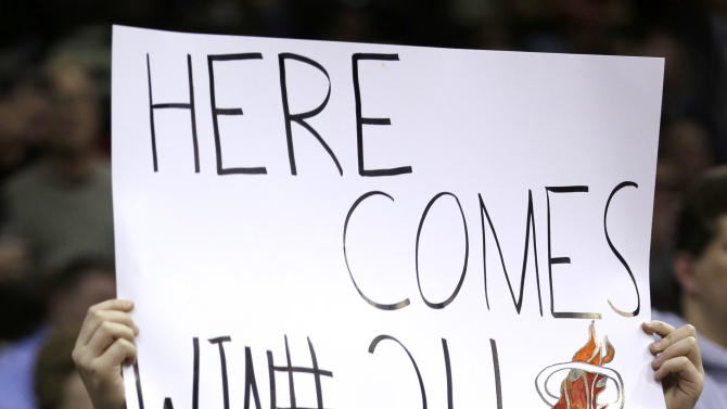 Dylan Karlovic, 11, holds up a sign before the Cleveland Cavaliers play the Miami Heat in an NBA basketball game, Wednesday, March 20, 2013, in Cleveland. Miami won 98-95. (AP Photo/Tony Dejak)