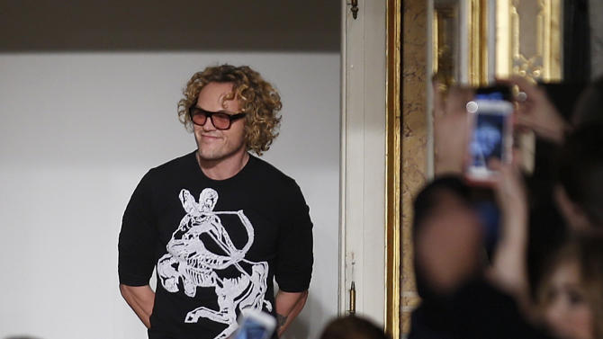 Norwegian fashion designer Peter Dundas acknowledges the applause of the audience after presenting the Emilio Pucci women's Fall-Winter 2015-16 collection, part of Milan Fashion Week, unveiled in Milan, Italy, Saturday, Feb. 28, 2015. (AP Photo/Luca Bruno)