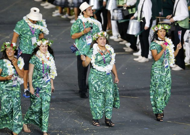 Members of the Cook Islands' contingent take part in athletes parade during opening ceremony of London 2012 Olympic Games at Olympic Stadium