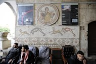 Syrian rebel fighters sit below Roman-era mosaics in Maaret Al-Numan. At least 18 ancient mosaics depicting scenes from Homer&#39;s &quot;The Odyssey&quot; have been stolen in northern Syria, the culture minister was quoted as saying on Sunday