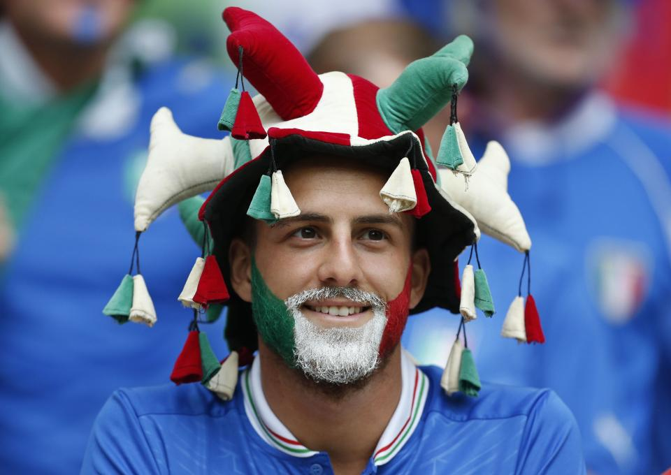 An Italian soccer fan waits for the kickoff of the Euro 2012 soccer championship semifinal match between Germany and Italy in Warsaw, Poland, Thursday, June 28, 2012. (AP Photo/Jon Super)