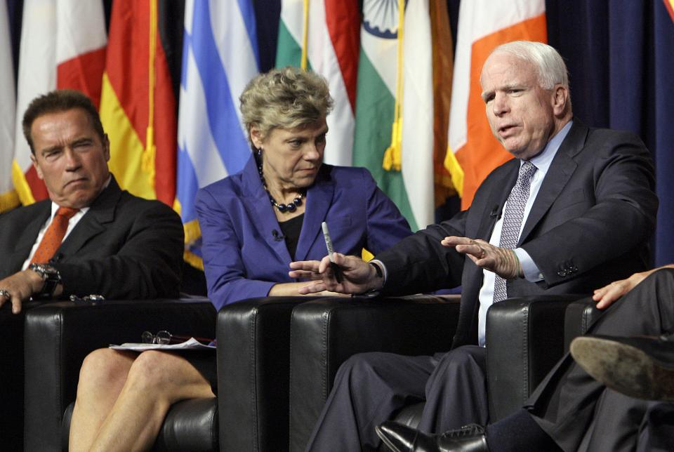 Former California Gov. Arnold Schwarzenegger, left, and moderator Cokie Roberts listen as Sen. John McCain, R-Ariz., speaks at the inaugural symposium sponsored by the Schwarzenegger Institute for State and Global Policy, at the University of Southern California in Los Angeles Monday, Sept. 24, 2012. (AP Photo/Reed Saxon)