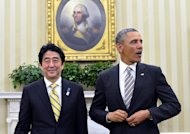 US President Barack Obama (R) and Japan&#39;s Prime Minister Shinzo Abe finish their bilateral meeting in the Oval Office at the White House, in Washington, DC, on February 22, 2013. Obama said the US and Japan are committed to &#39;strong actions&#39; in response to North Korea&#39;s &#39;provocations&#39; as he welcomed Japan&#39;s premier