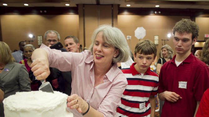 Frances Newby slices a wedding cake to celebrate the passage of Amendment One during an election night party in Raleigh, N.C. on Tuesday May 8, 2012. North Carolina voters approved the constitutional amendment Tuesday defining marriage solely as a union between a man and a woman, becoming the latest state to effectively slam the door shut on same-sex marriages. (AP Photo/The News & Observer, Robert Willett) MANDATORY CREDIT