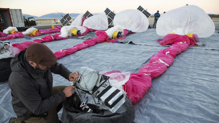 In this June 10, 2013 photo released by Google, Jordan Miceli prepares electronics to launch balloons in Tekapo, New Zealand. Google is testing the balloons which sail in the stratosphere and beam the Internet to Earth. (AP Photo/Google, Andrea Dunlap) EDITORIAL USE ONLY