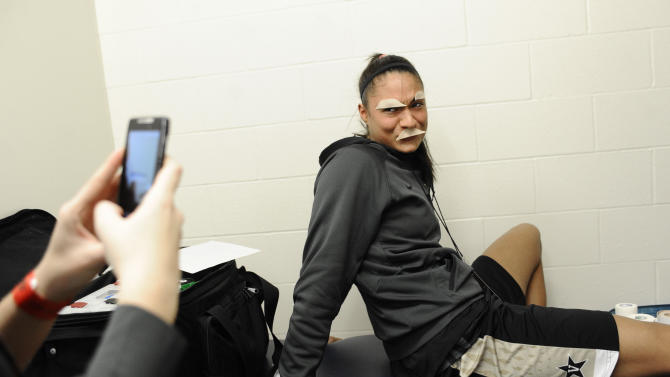Vanderbilt's Elan Brown wears tape on her face in an impersonation of Charlie Chaplin while joking around in the locker room before practice for a second-round game in the women's NCAA college basketball tournament in Storrs, Conn., Sunday, March 24, 2013. Vanderbilt is scheduled to play Connecticut Monday. (AP Photo/Jessica Hill)