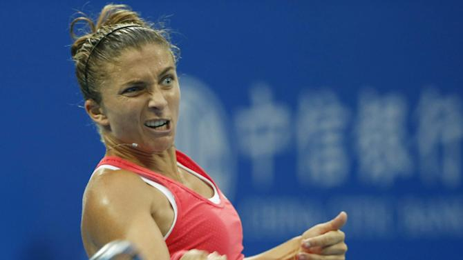 Sara Errani of Italy hits a return against Petra Kvitova of the Czech Republic during their women's singles match at the China Open tennis tournament in Beijing
