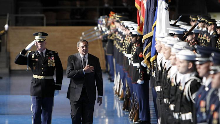 Army Col. James C. Markert, left, escorts outgoing Defense Secretary Leon Panetta during an Armed Forces Farewell Ceremony to honor Panetta, Friday, Feb. 8, 2013, at Joint Base Myer-Henderson Hall in Arlington, Va. (AP Photo/Ann Heisenfelt)