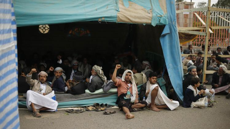 Followers of the Shi'ite Houthi movement sit in a tent at an anti-government protest camp in Sanaa
