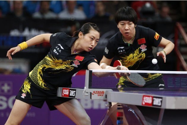China's Li and Guo play against compatriots Liu and Ding in their women's doubles final at the World Team Table Tennis Championships in Paris