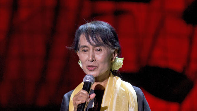 Myanmar opposition leader Aung San Suu Kyi speaks after receiving the Amnesty International's Ambassador of Conscience award in Dublin, Ireland, Monday, June  18, 2012. The award was made in 2009, and this is the first opportunity for Kyi to receive the award due to her house arrest in Myanmar.(AP Photo/Alastair Grant)